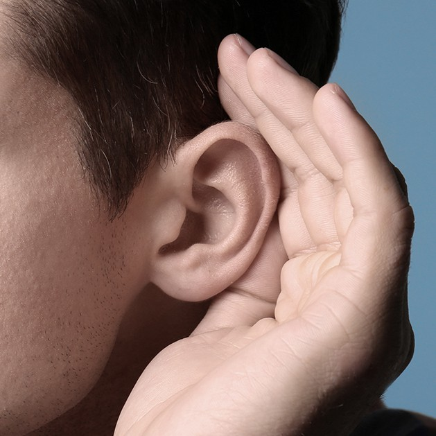 Man trying to hear   Hearing test in Lubbock